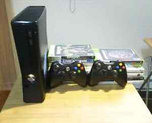 Xbox 360 slim + controllers + 13 games and headsets!