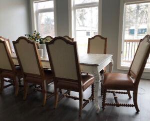 Offering eight Oak Cromwellian style studded chairs and a French
