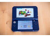 Nintendo 3DS XL (metallic blue) + 3 games (hardly used)