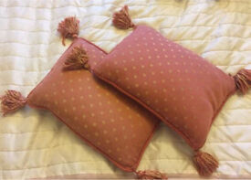 Two small terracotta cushions / pillows