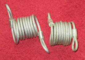 2 - SECURITY CABLES 6' LONG - BRAND NEW - vinyl coated, self coiling, deouble loop, no locks cables