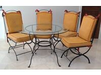 Glass dining room table with steel frame and matching chairs