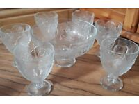 Six glass sundae/dessert dishes and large punch bowl. NEVER USED.