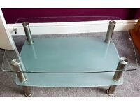 Clear glass table/TV stand