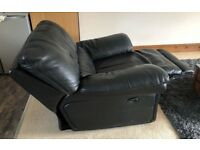 Electric reclining black soft leather armchair