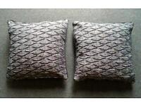 2 black and white cushion and covers