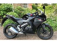 Honda CBR125R in Midnight Black with a full service history, one owner £2400