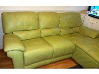 Leather corner sofa and ottoman.