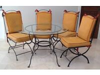 Steel Frame dining table with glass top (diam 114cm) with matching chairs