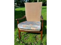 Parker knoll style easy chair with Danish style legs and arms high backed