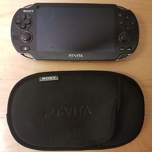 PS Vita + Memory Card and 6 Games