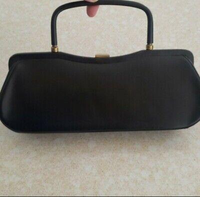 1950s Handbags, Purses, and Evening Bag Styles Vintage 1950s purse Rectangle handbag metal handles black 50s Retro doctor bag $20.00 AT vintagedancer.com