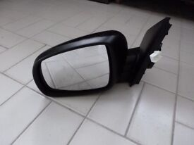Electric door mirror, passenger side, for Nissan Note 2007 (fits 2006-2010), good condition.