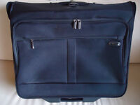 As new Kenneth Cole wheeled garment bag - great for dresses/suits - overnight trips