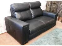 Black leather 2x 2 seater sofas. Delivery available