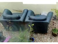 Free first come first served... 2 very comfy dark green leather arm chairs