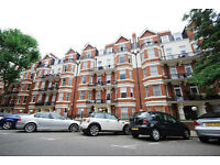 Three bedroom flat in a mansion block in Maida Vale W9
