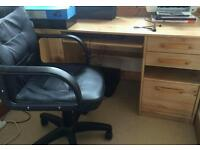 Desk, office chair and shelving unit