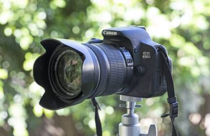 Canon EOS 650D camera with lenses and accessories