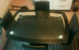 Black glass /chrome dining table and 4 leather chairs