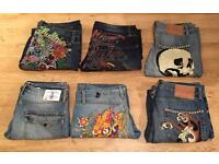 6 pairs of brand new vintage Ed Hardy and Christian Audigier men's jeans. Waist sizes 32,33,34