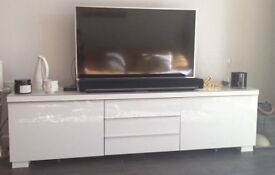 Brand new tv stand from Ikea with glass top protection