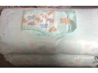 2 large packs nappies