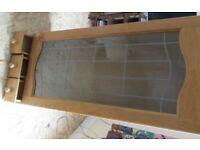 Kitchen cupboard with glass door.