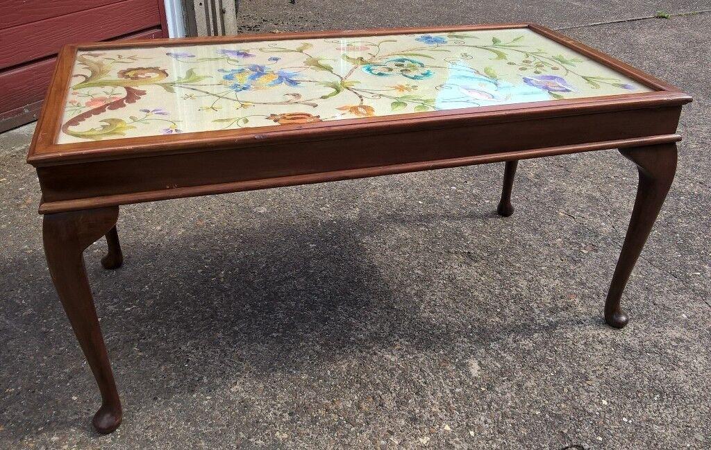 Pretty dark wood coffee table with Queen Ann legs