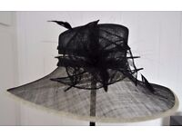 M&S Black Wedding Hat with cream edging detail. Flower to front. One size. PRICE REDUCED
