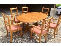 Solid extending pine pedestal dining table and 6 chairs