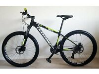 "Like new Cannondale Trail 7 mountain bike - Very light - 26 "" wheels - 24 gears - 215 pounds ovno"