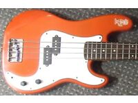 Short Scale P bass. Much tweaked and worn...but not out. Same scale length as Fender Jaguar.
