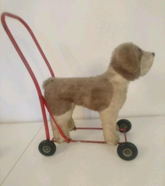 Vintage toy dog on wheels baby walker push along