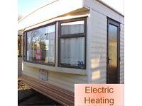 Static caravan 28 x 12 ft 2 bedrooms + electric heating - nice condition, bargain price!