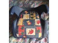 Padded bottom car booster child seat with arm rests