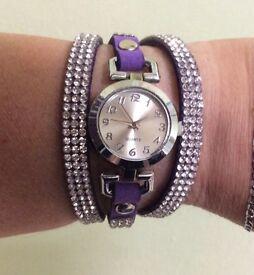 Purple suede ladies Quartz watch.