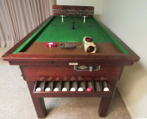 Bar billiards table with skittles and accessories