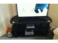Black tv unit, coffee table and nest of tables
