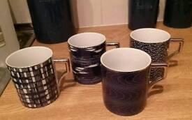 Set of 4 china mugs
