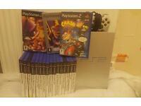 PS2 + 22 Games (Spyro, Crash Bandicoot)