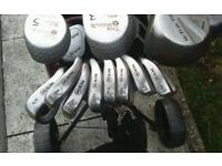 Bag with spotless drivers, irons, putter, pitcher, sander iron