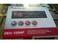 Pioneer DEH 150 MP radio cd mp3 (and audi a4 install kit at ariel)