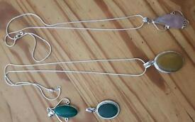 Four silver pendants and 2 silver chains