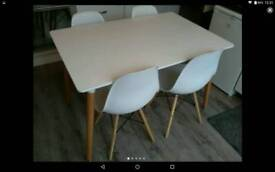 Very modern dining table and 4 chairs