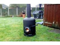 Outdoor wood burner heater from a empty gas bottle