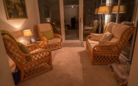 Cane Conservatory three piece suite + glass top cane table all in good condition