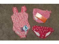 Baby girl swimming costume and swim nappies. Never worn 2 with tags