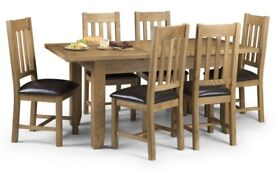 Parker/ Astoria oak extending table and 6 chairs.