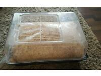 Hamster cage with straw